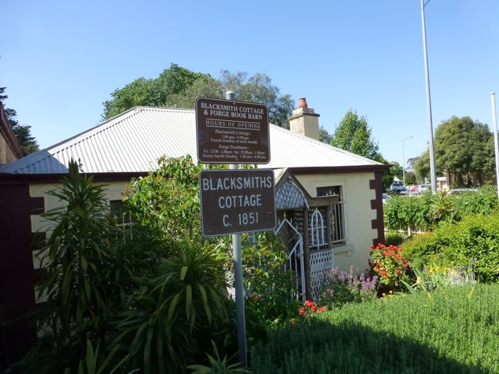 blacksmiths-cottage-ext-with-sign