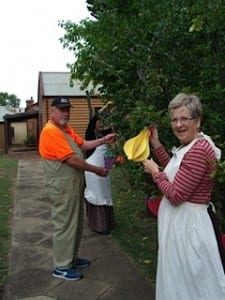 Volunteers Stan and marjorie Bell along with jean Lycette adorned the quince tree with 'fruit'